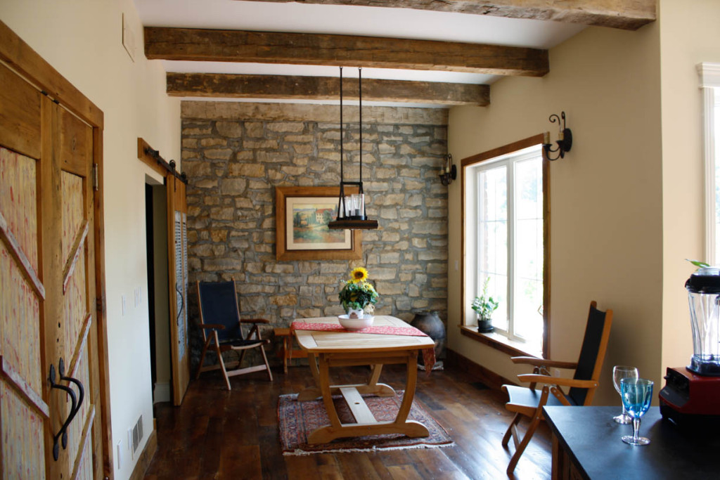 feature stone wall and rough cut beams